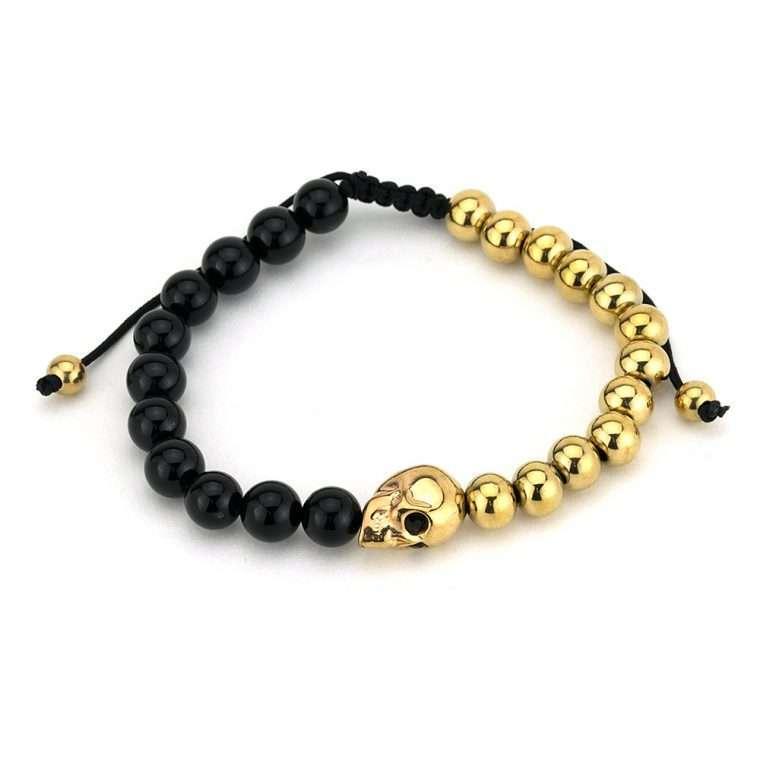 Βραχιόλι πέτρες black onyx half gold skull.