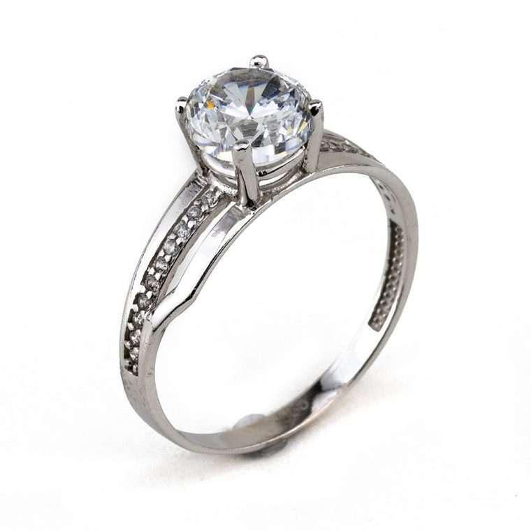 Moνόπετρο δαχτυλίδι από λευκόχρυσο 14Κ με πέτρες ζιργκόν.