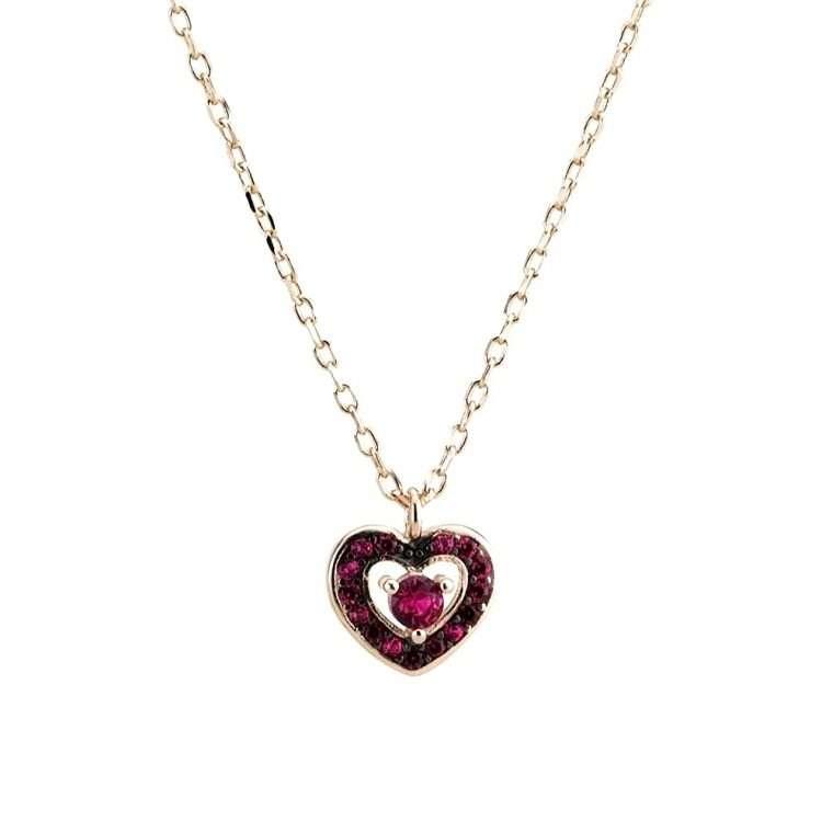 Γυναικείο ασημένιο κολιέ καρδιά με πέτρες σε ροζ χρώμα.