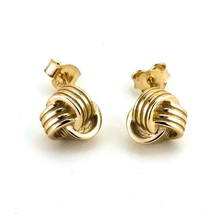 Aσημένια σκουλαρίκια κόμπος σε χρυσό χρώμα.